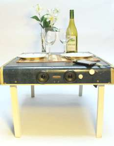 Turn a vintage suitcase into a table with retractable legs and speakers